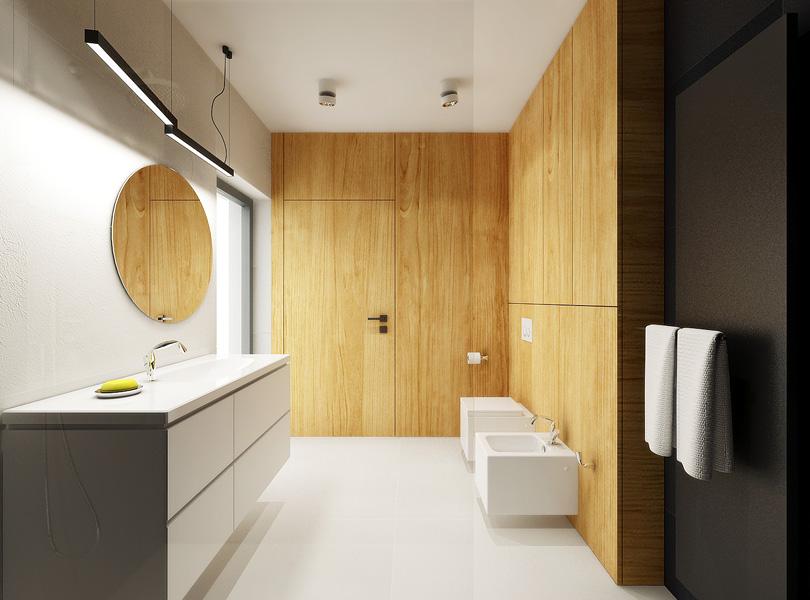 łazienka z czarnymi płytkami oraz drewnem