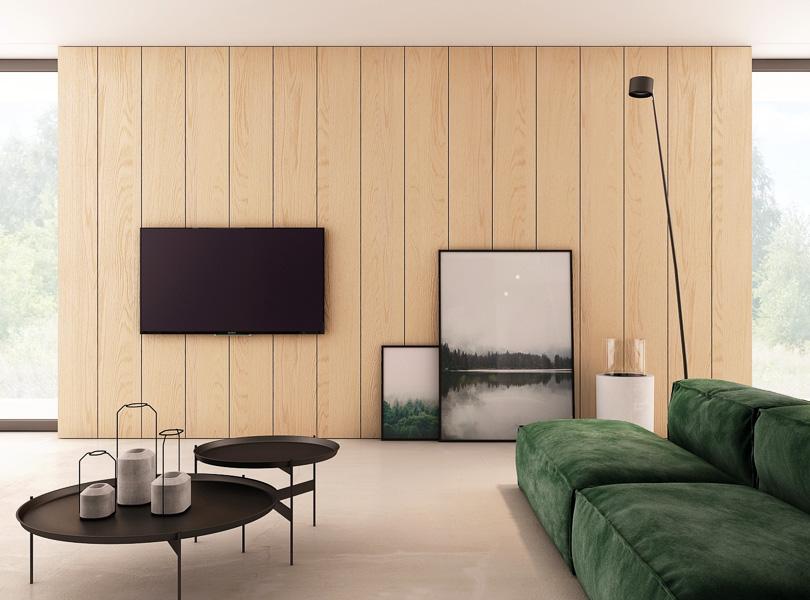 deski na ścianie TV, zielona sofa i posadzka z mikrocementu