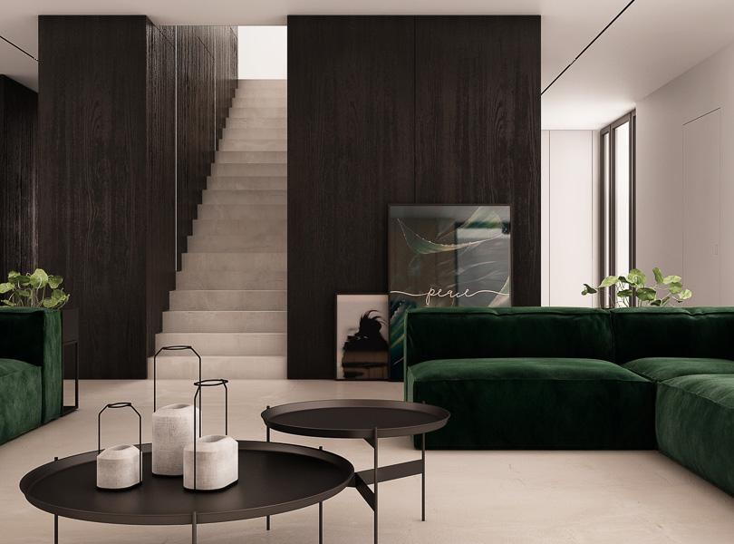 widok na schody, sofa w kolorze butelkowej zieleni, czarny fornir na ścianie