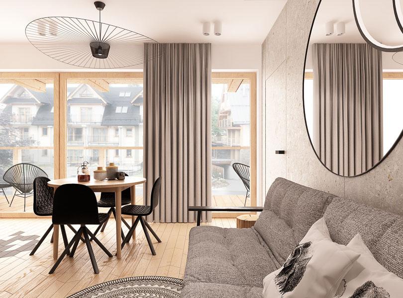 Projekt wnętrz mieszkania na wynajem w Zakopanem. Salon z aneksem kuchennym. Lustro i piękna lampa nad stołem.