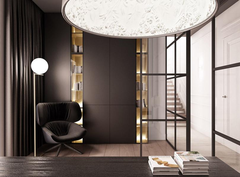 Ciemne wykończenie gabinetu w połączeniu ze złotymi, podświetlanymi witrynami tworzy klimatyczny, elegancki charakter wnętrza.