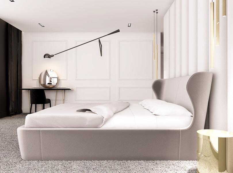 elegancka sypialnia z tapicerowaną ścianą i złotymi dodatkami