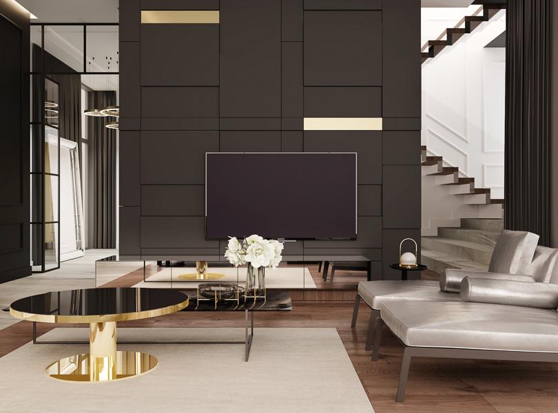 Ściana TV i widok na schody. Między salonem a holem zastosowano lekką przeszkloną ściankę z delikatnymi szprosami.
