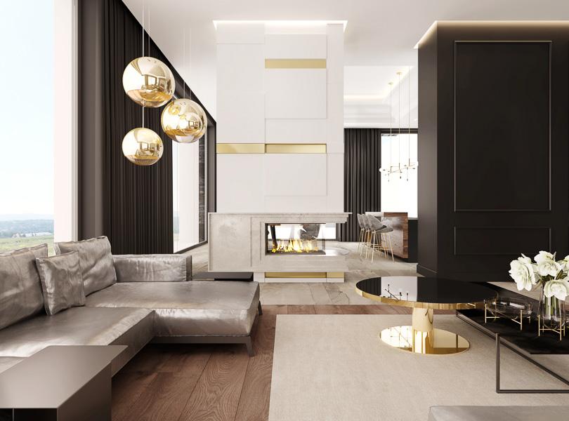 Złote dodatki w salonie. Czarna ściana ze sztukaterią. Ciekawa zabudowa kominka ze złotymi elementami.