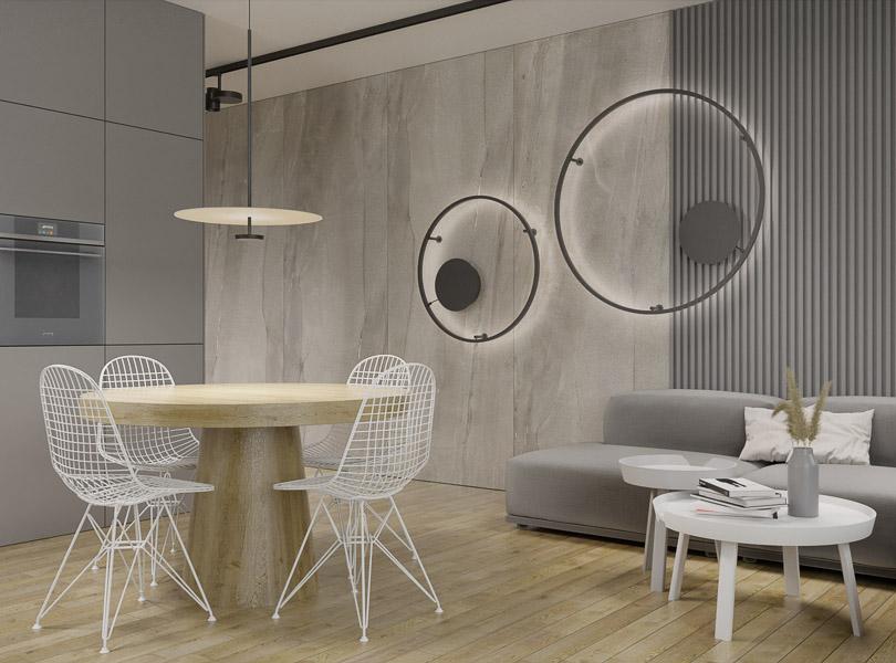 Minimalistyczny salon połączony z kuchnią. Na ścianach zastosowaliśmy płyty wielkoformatowe.