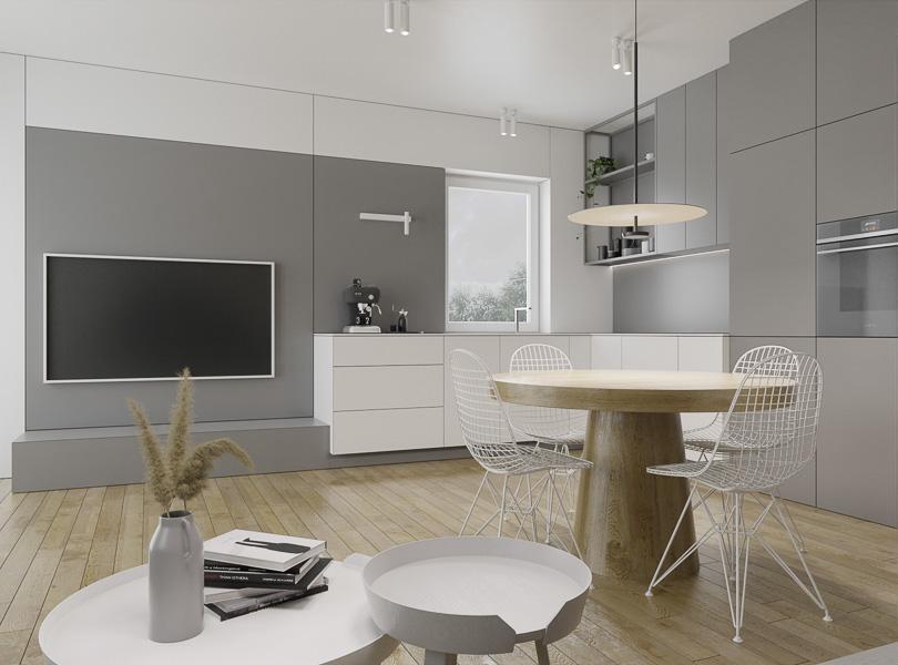 Jasna, minimalistyczna kuchnia połączona z salonem.
