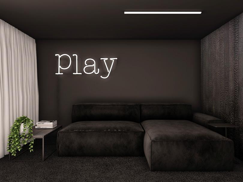 pokój kinowy z miejscem do pracy