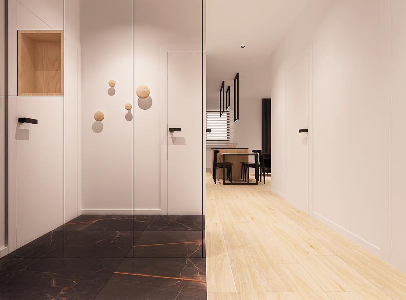 Minimalistyczny korytarz. Szafa z frontami z luster.